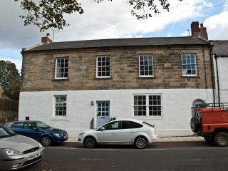 The Old Post Office Alnmouth.  On the village street but with off-road parking for your cars!