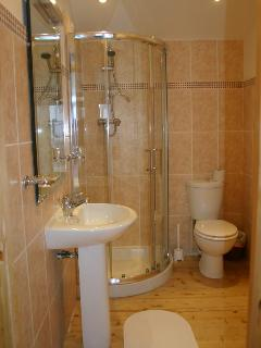 Small ensuite in carriage house bedroom all tiled, OFCH in all rooms