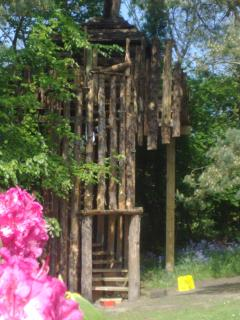 Big tree house and spiral stairs in front garden (shared)