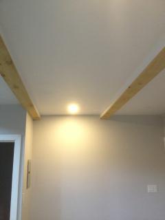 Cedar beam span the entire suite, adding warmth
