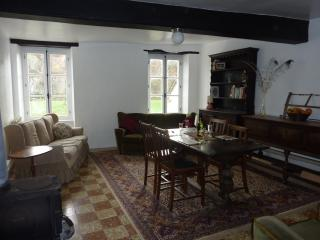 Open plan lounge with dining area and breakfast bar, elevated views over canal, woodburner & DVD