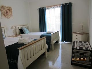 Twin bedroom opens onto Juliet balcony