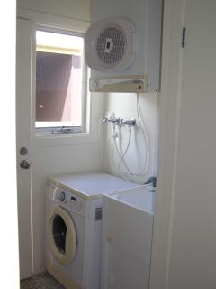 Fully equipped laundry includes washing machine, dryer, iron & ironing board & vaccuum clean