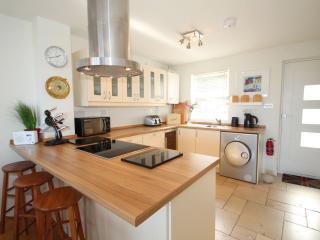 Stylish kitchen: oven, hob, fridge, freezer, dishwasher, wine fridge, washing machine & dryer.