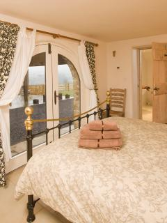 The groundfloor master bedroom has fabulous views across the garden and Danby Dale