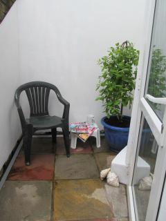 Secluded small patio area outside entrance to apartment