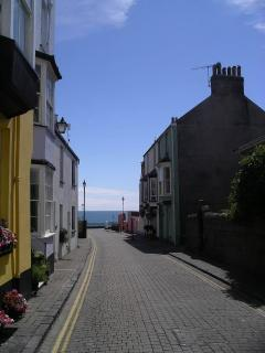 View down St Mary's Street to the sea on a beautiful summer day