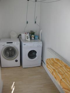 Laundry Room with washing machine, tumble drier, ironing board and iron