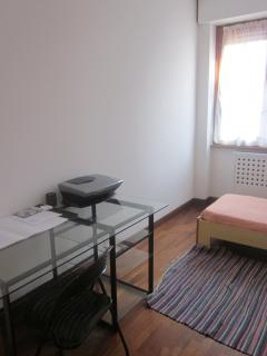 3st bedroom with 2 single beds , wardrobe and desk.