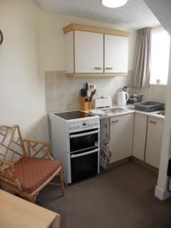 Fully equipped kitchen with dining area and sea views.