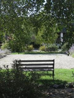 Relax in the shade under the trees around the boules court
