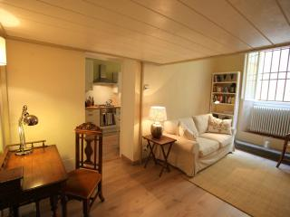 The living room with sofa and writing desk