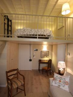 Big double bed on mezzanine floor