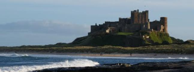 Bamburgh Castle from the beach, one of Northumberland's many stunning Castles