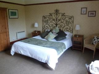 Comfort and a bit of deserved luxury in our kingsize bed on the ground floor of the cottage