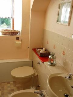 The family en-suite with shower over bath