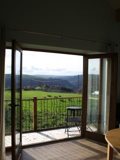 9 foot patio doors open onto a lovely balcony. Ideal for sitting/eating out & wathching the sun