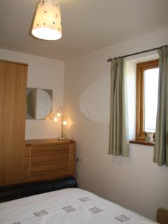 The bedroom has a double bed & a single put-bed. Excellent views across to Heptonstall & Old Town