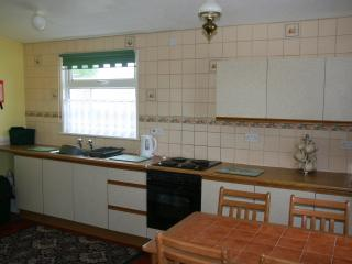 Spacious Kitchen/Dining area with cooker, microwave, kettle and toaster