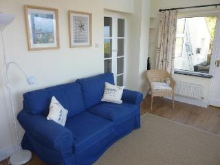 Comfortable sitting room with panoramic views of Dinas Head and the sea