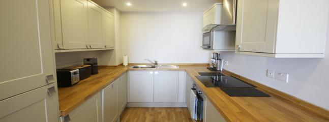 Fully-fitted kitchen stylishly kitted with all the modern conveniences