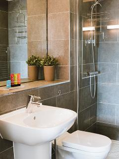 En-suite to bedroom 1, with a walk-in shower cubicle, rain shower, and heated towel rail