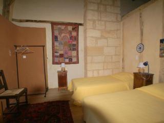Gite Glycine upsatirs bedroom with en suit bathroom