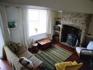Comfortable sitting area with antique French stove - warm and cosy when you need it
