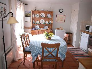 The kitchen has a dining area and French windows leading out to a small garden