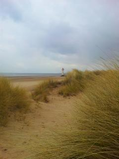 Nearby Talacre lighthouse on our dog friendly beach.
