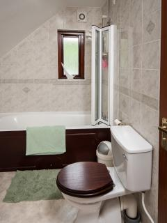 bathroom with over bath electric shower