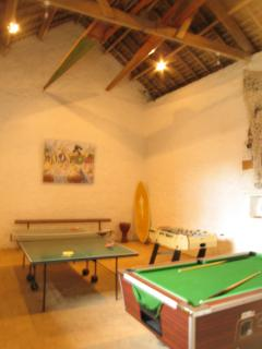 Huge games barn with pool table and table football and table tennis table  Rowing boats in the roof!