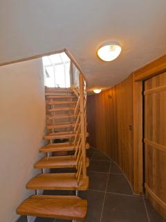 Entrance hall and bespoke staircase leading up to the kitchen and living rooms.