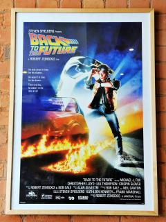 One of the collection of movie posters in the apartment, 'Back to the Future'.