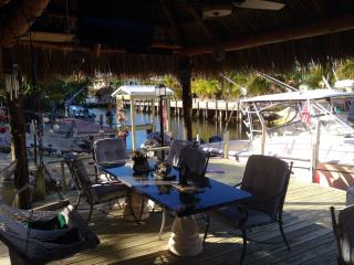Spacious tiki with granite dining table and large screen TV.