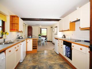 Open plan kitchen diner in cottage on farm