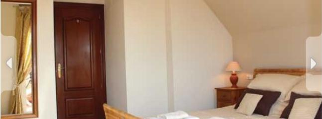Very large master bedroom with en suite and patio doors leading to a private terrace.