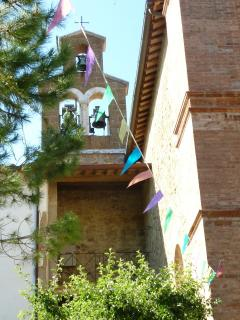 Bell tower of local village church that softly chimes the hours across the valley
