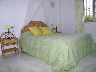 Large double main bedroom with air/con & ceiling fan, large wardrobe.