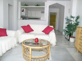 Large lounge with air/con & ceiling fans, with door leading to large sunny terrace.