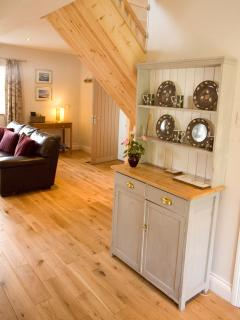 The characterful oak floor is cosy with underfloor heating.