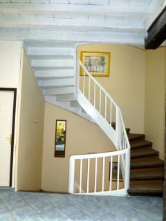 Staircase from dining room to first and second floors.  The Safari and green rooms are on this floor