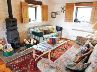 Well equipped living room with wood-burning stove (on first floor to take advantage of view)