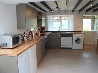 Spacious, contemporary kitchen with underfloor heating and views of the Dale
