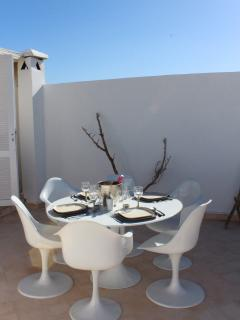 Dining table on roof top terrace