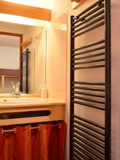 Newly renovated bathroom with towel radiator