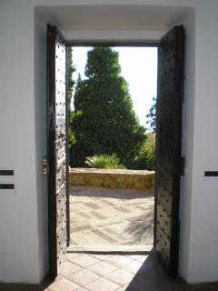 The door on the stone paved terrace