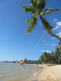 sophie on a beach swing