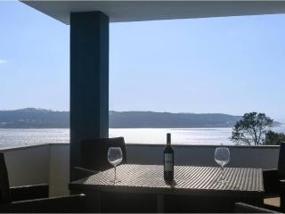 An unbeatable view of the lagoon from balcony at front of villa