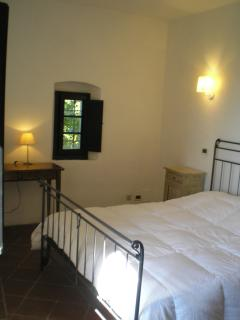 Bedroom 2 with bed in wrought iron